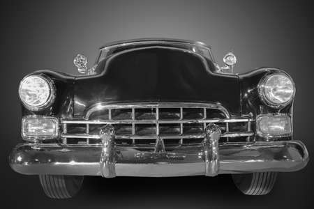 old fashioned car: beautiful ancient black car against dark background Stock Photo