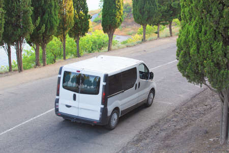 minibus: minibus moves on the highway against the hill