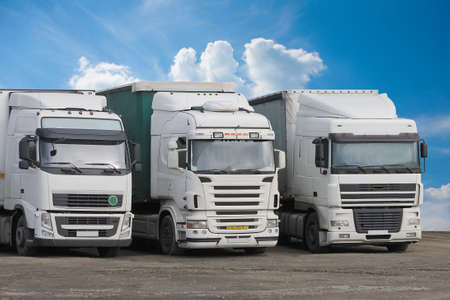 front view: trucks on parking on cloudy sky