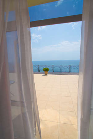 view on sea: view of sea from a hotel room in summer Stock Photo