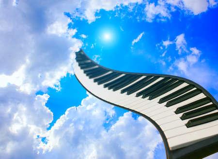 piano keys against cloudy solar sky