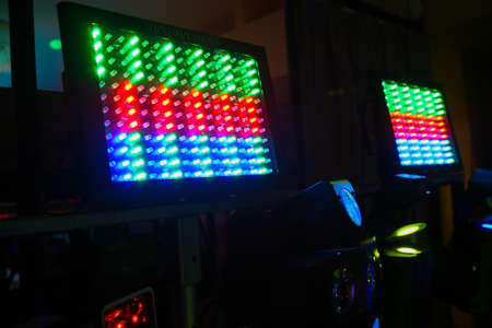 screen partition: panels with diode lamps of different colors against dark background