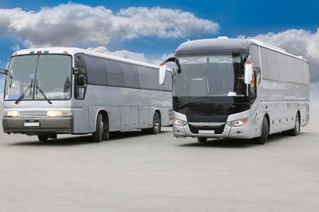 distance: tourist buses on asphalt against sky Stock Photo