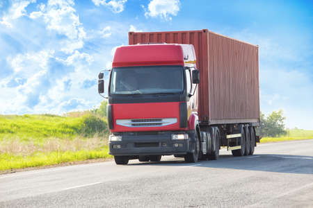 red sky: truck transports freight on the country highway