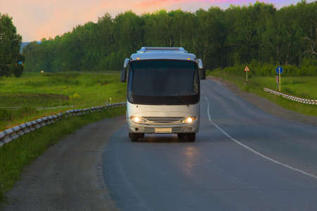 country highway: bus goes on the country highway Stock Photo