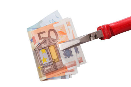 clamped: euro banknotes clamped in flat-nose pliers close up Stock Photo