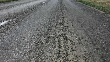 asphalt paving: asphalt paving on highway turn closeup Stock Photo