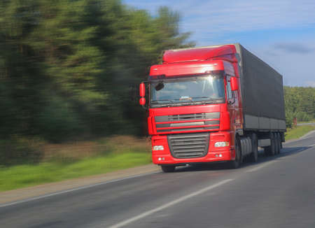 lorry: red truck transports freight on the highway