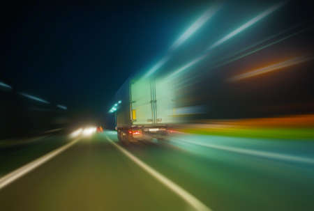 tripping: truck moves on country highway at night Stock Photo