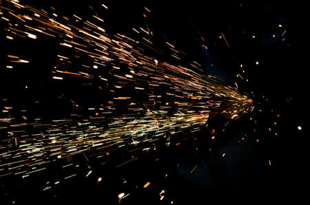 bright sparks of metal against dark background