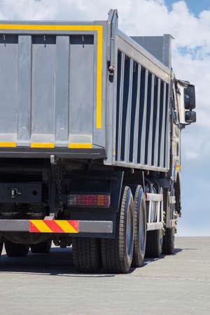 truckload: big dump truck goes  on highway Stock Photo