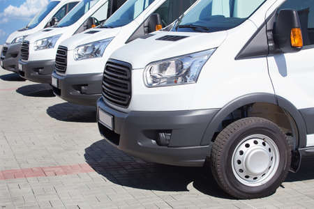 number of new white minibuses and vans outside 스톡 콘텐츠