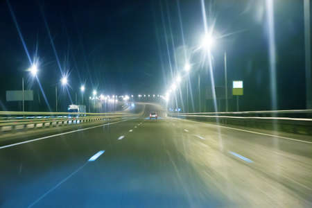 multiple lane highway: night highway with moving cars Stock Photo
