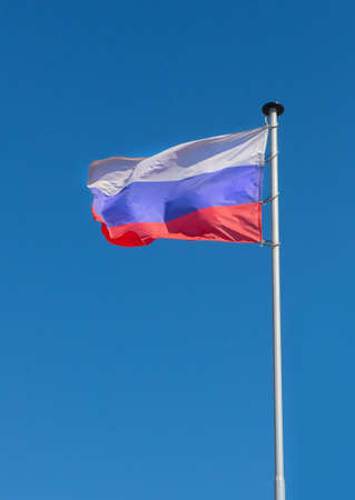 pulsating: flag of Russia fluttering on wind against the sky