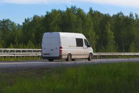 country highway: minibus goes on the country highway along the wood