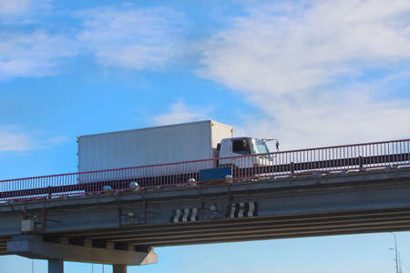 delivers: truck delivers freight on bridge against sky Stock Photo