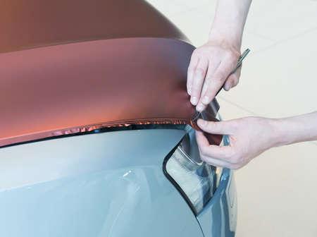 shop skill: pasting of car carbonic plastic closeup
