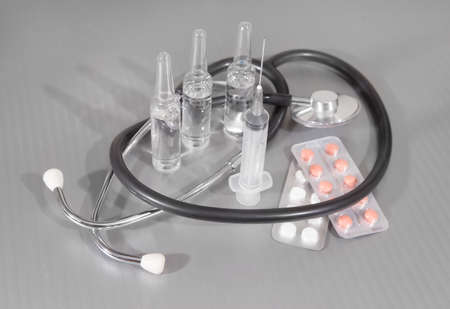 stethoscope shritsa tablet ampoule on gray background