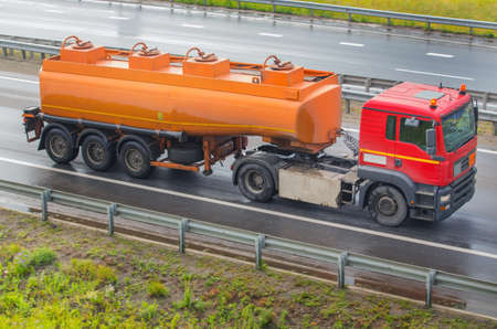 fuel tanker track moves on highway Stock Photo