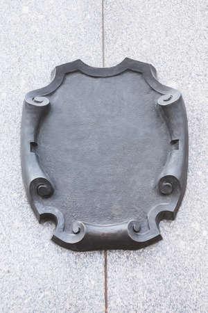 granite wall: metal decorative plate on granite wall