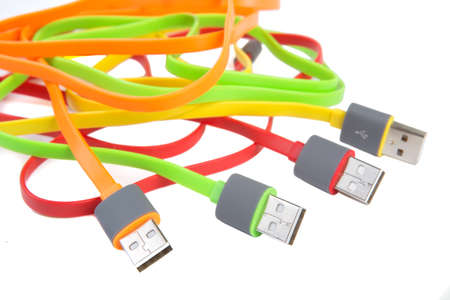 color wires with plugs on white background Stock Photo