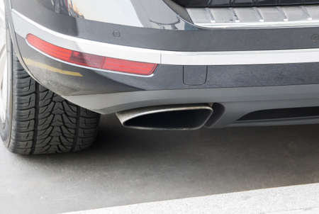 exhaust pipe: exhaust pipe and back part of new car Stock Photo