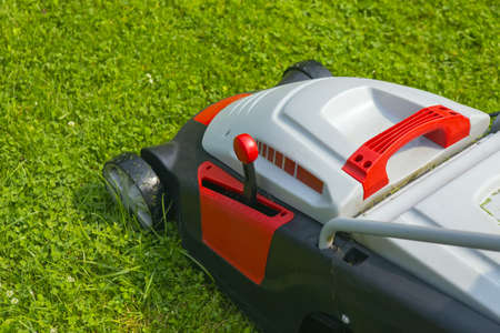 lawn-mower electric on green grass closeup