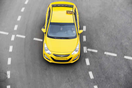 black car: yellow taxi moves on the city Stock Photo
