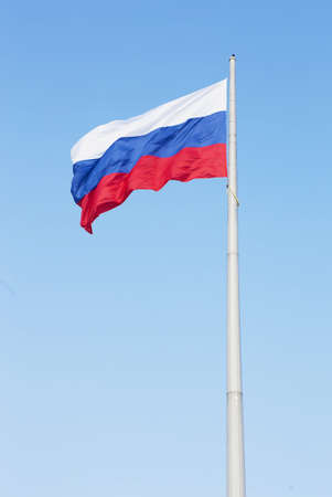 flag of Russia fluttering on wind against sky Stock Photo
