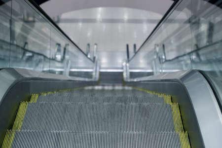 escalator steps in an interior of shopping center