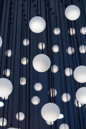 architectural lighting design: modern chandelier with spherical plafonds