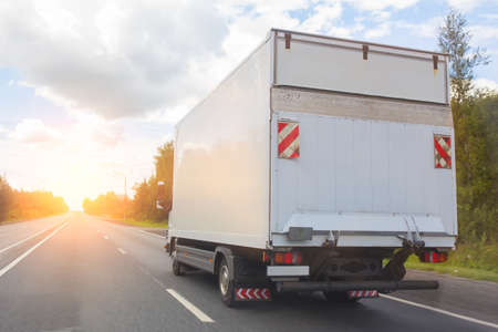 truck goes on the highway to sunrise Stock Photo