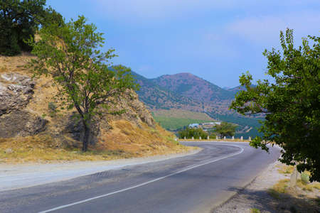 thoroughfare: Crimea the twisting highway in the mountain district Stock Photo
