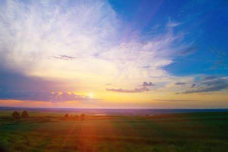 beautiful sky: beautiful bright sunset in cloudy sky