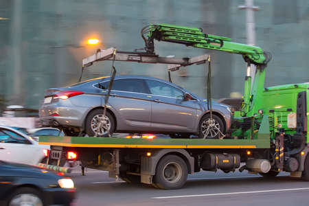 rescue: tow truck transports cars on city street