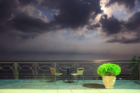 Night landscape at the sea on the balcony parapet