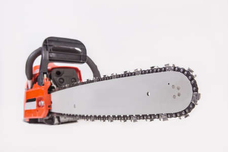 sawyer: Electric chain saw red isolated close-up