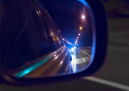 reflection in the mirror the night riding on the road cars