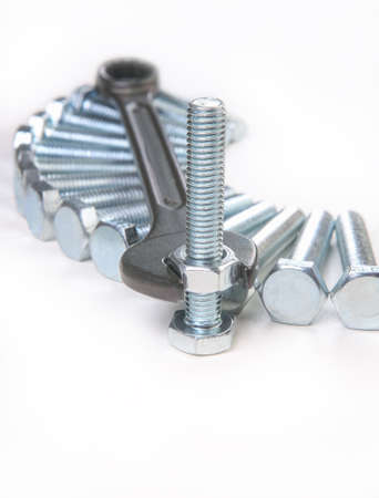 wrench bolts nuts on white background
