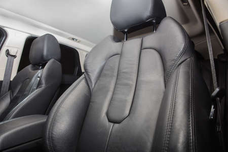 black car: black leather front seat in the car