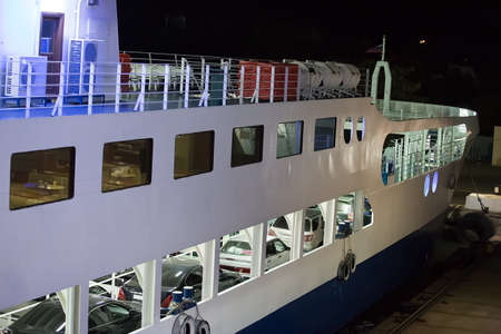 disembarking: Ferry with cars at night at the pier Russian Crimea