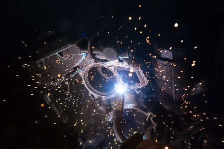 Welding work on a car engine close-up