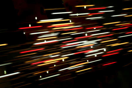 brightly colored: Colored blurred lines of light on dark background Stock Photo