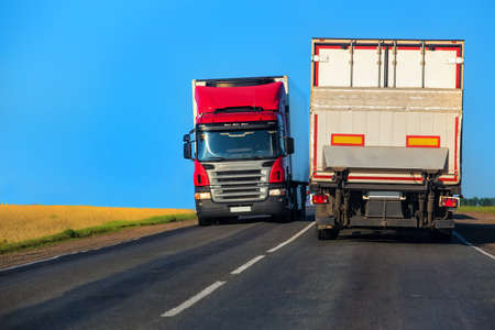 truck driver: trucks transporting freight on the country highway