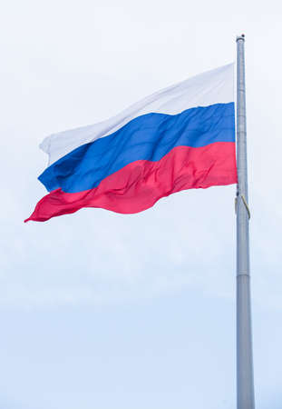 Flag of Russia fluttering on wind against sky
