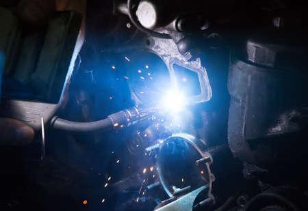resplendence: Welding work on a car engine close-up