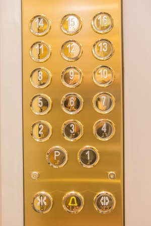 go inside: Gilded buttons for selecting floors in the elevator