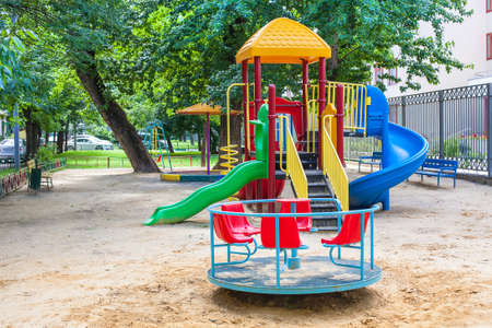playground of kindergarten with roundabout and sandbox Stock Photo