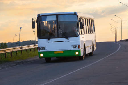 bus goes on the country highway Stok Fotoğraf