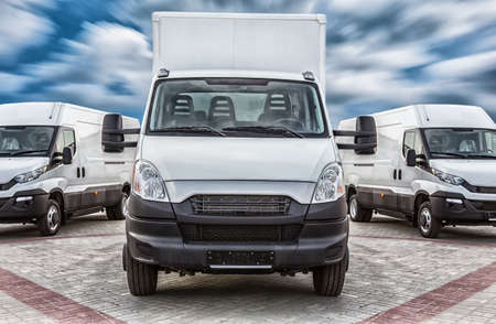 Transport truck and minivans cargo delivery Stock Photo